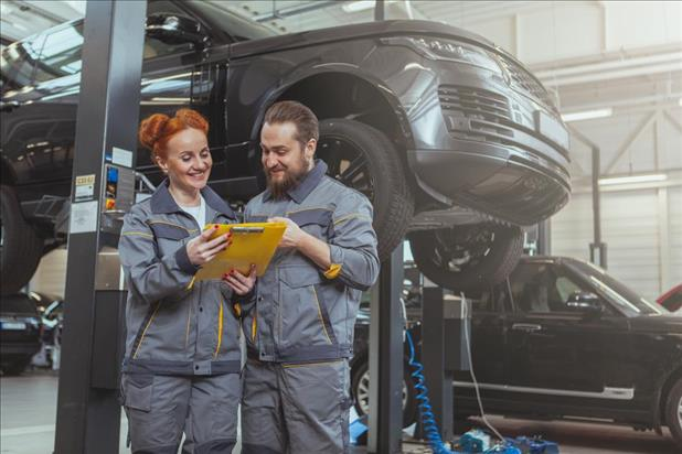 two automotive technicians working together in their shop