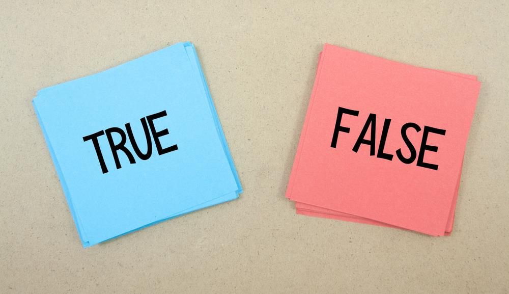 "Note pads with ""true"" and ""false"" written on them"