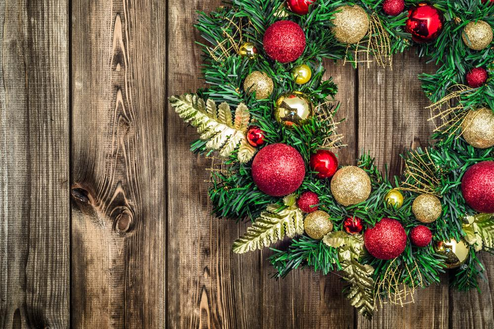 Christmas wreath resting on a wooden table