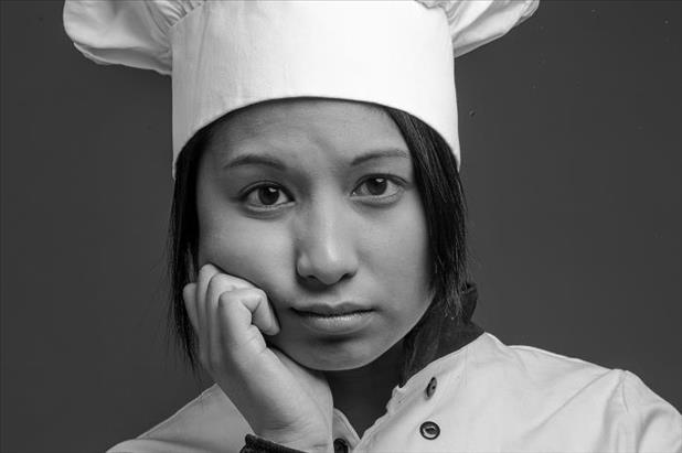 Upset chef thinking of how to respond to questions about being fired or laid off