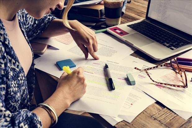 Woman highlighting skills in document