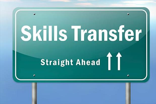 "Sign reading ""skills transfer - straight ahead"""