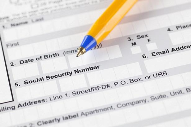Closeup view of employment form showing field for social security number