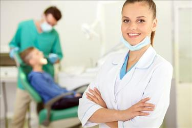 dental hygienist with arms crossed