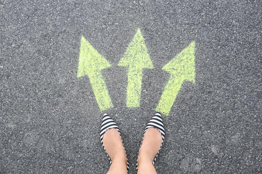 feet on the ground with three arrows pointing in different directions