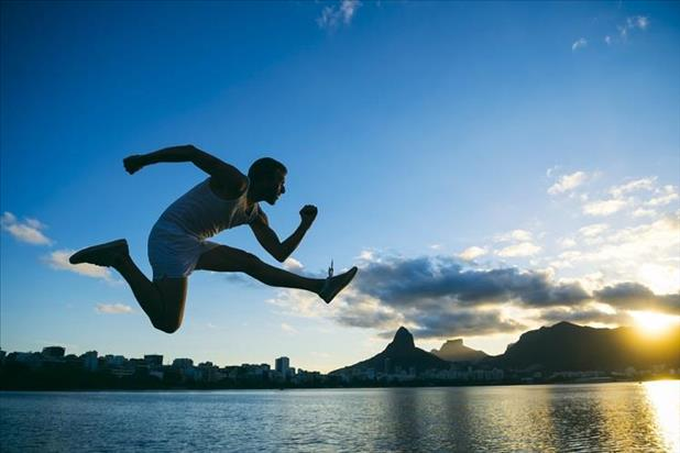 athlete jumping in front of the sunset skyline in Rio de Janeiro, Brazil
