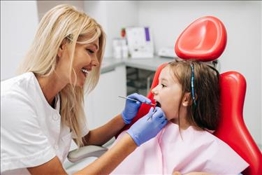 Dental hygienist with young patient