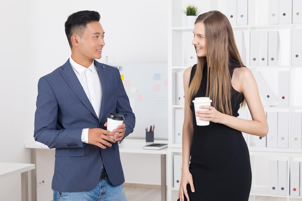 candidate at a company event talking to a current employee