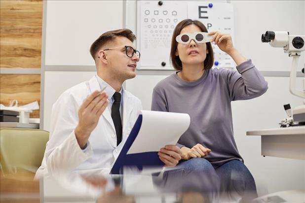 Recently graduated optometrist working with patient
