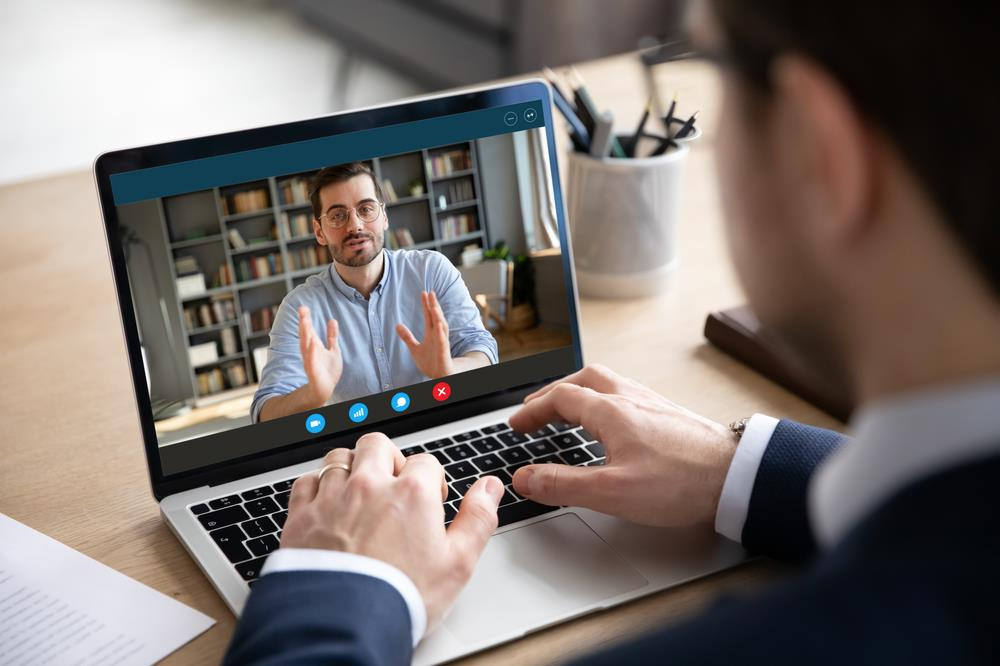job seeker interviewing for a remote position on his laptop