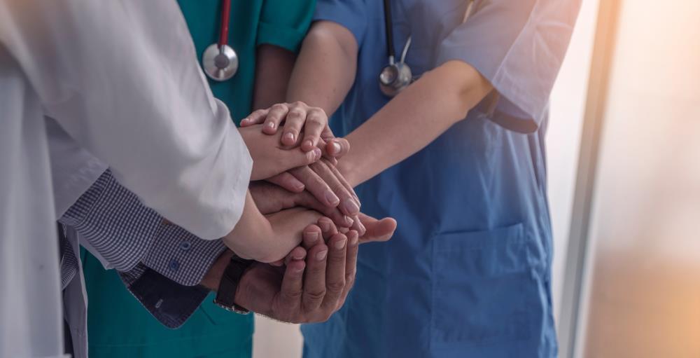 volunteer medical team putting their hands together