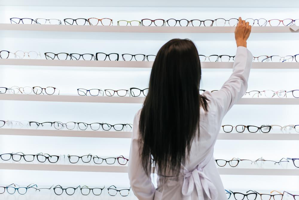Optician performing merchandising duties, which is a popular specialized skill for opticians.
