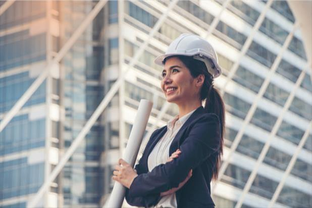 woman with a hardhat and diagrams
