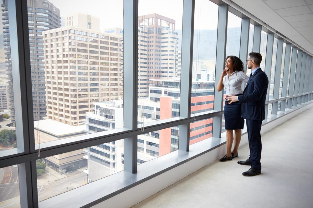 Commercial real estate agent showing client around an empty office building