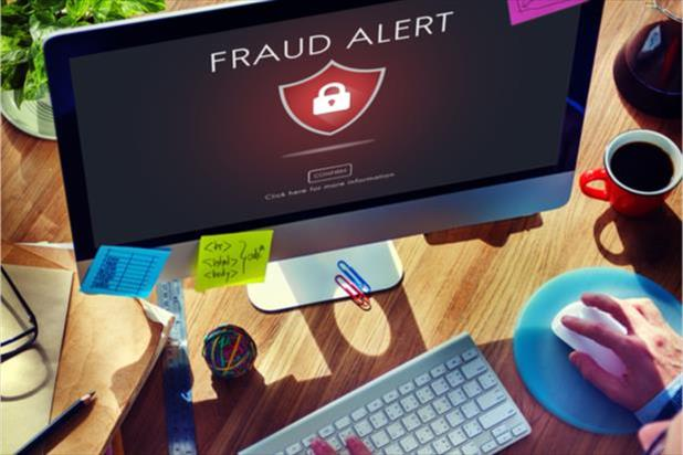 computer with a fraud alert notification