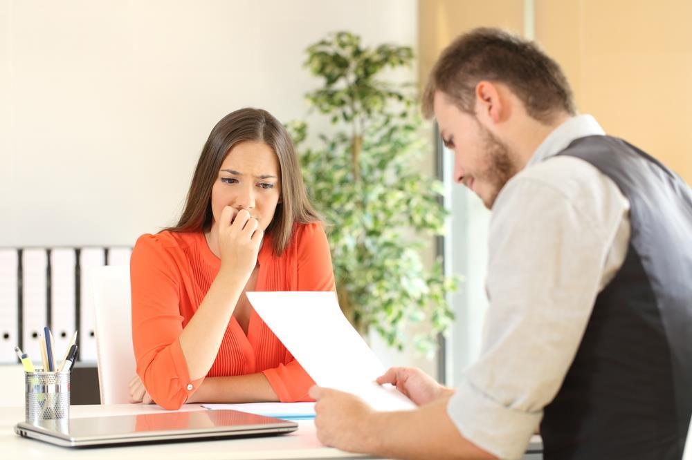 job seeker showing concern while interviewer reviews her resume
