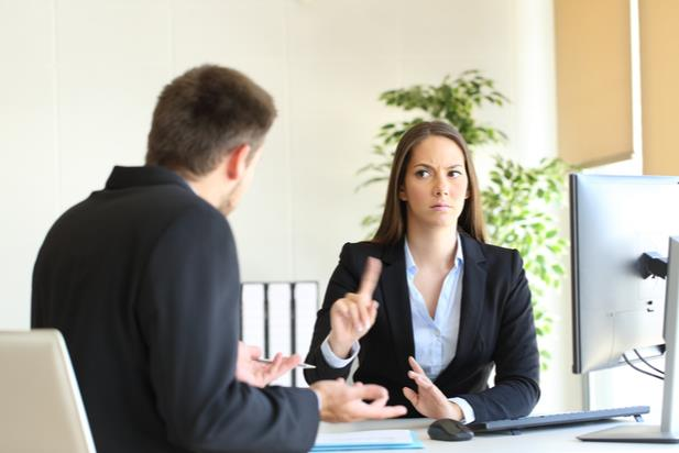 Candidate responding to hiring manager's low salary offer by waving her finger