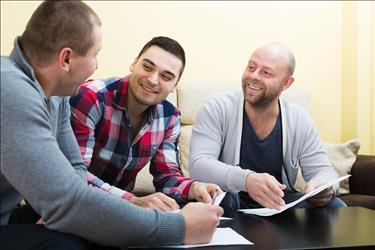 male social worker meeting with two clients