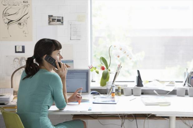 Professional sitting at desk and undergoing a phone interview