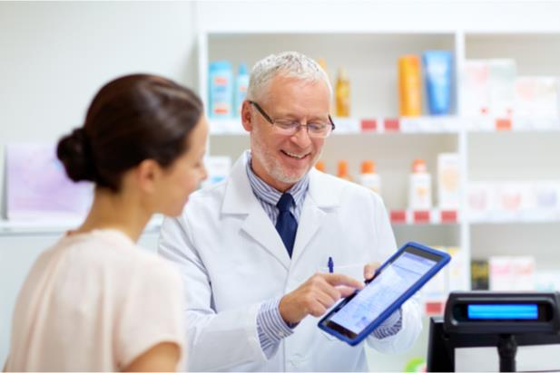 pharmacist assisting patient