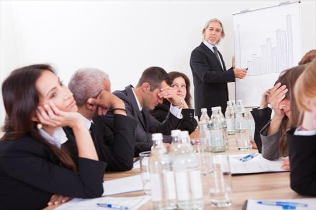 Group of professionals falling asleep in meeting and showing company's employee disengagement problem