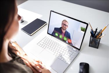 Job candidate and employer conducting a video interview