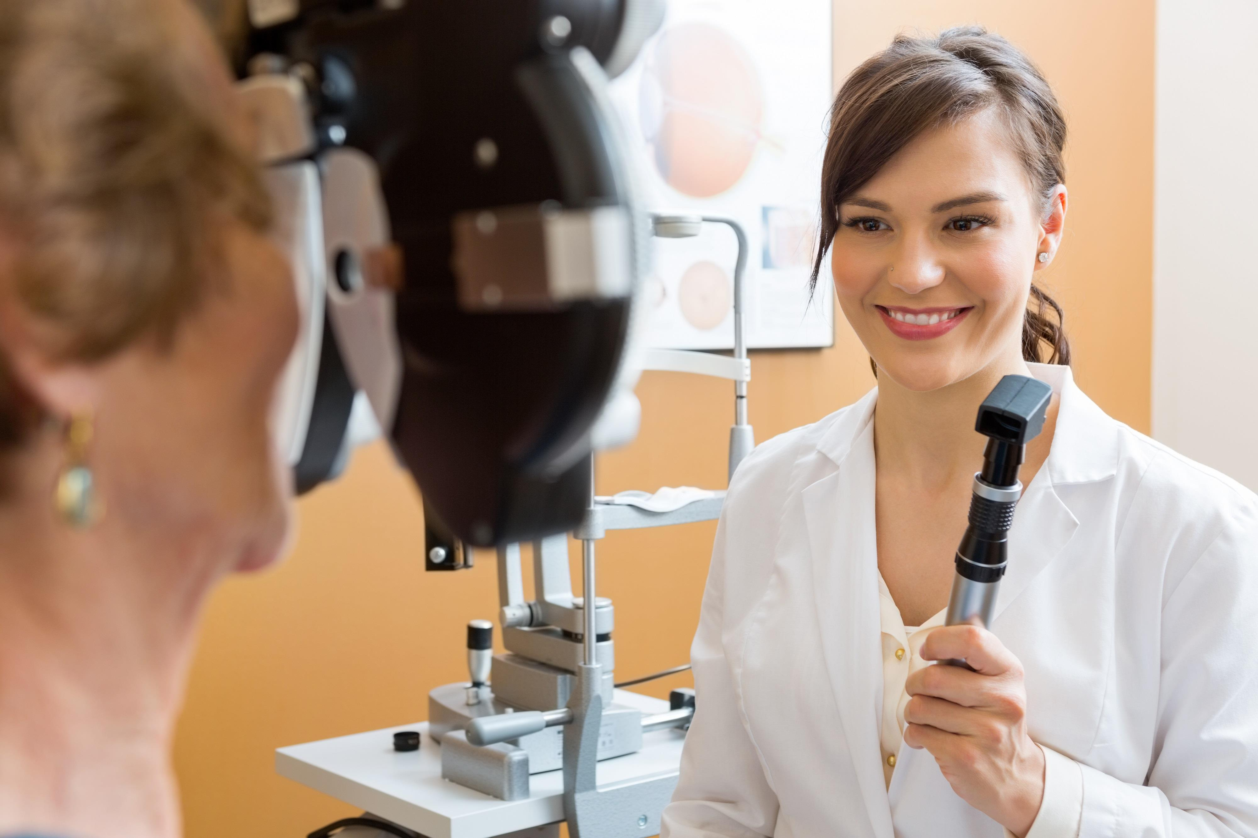 optometrist preparing to test a patient's eyesight