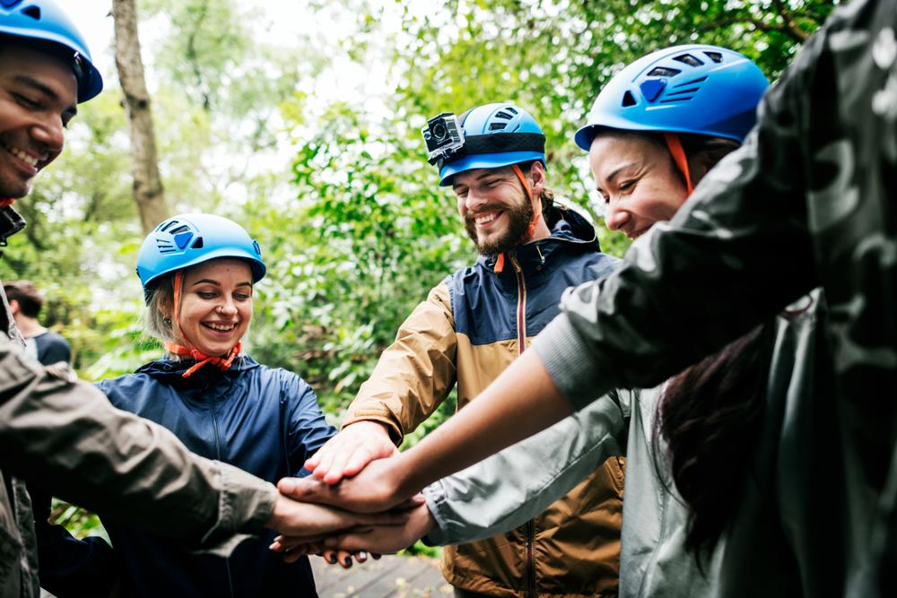 employees zip lining together for a team building event