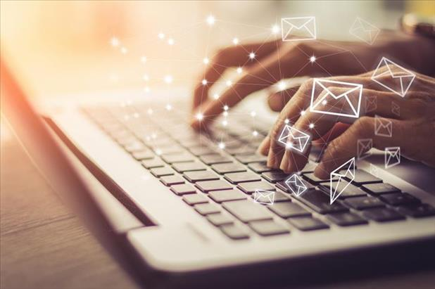 hand typing with email imagery