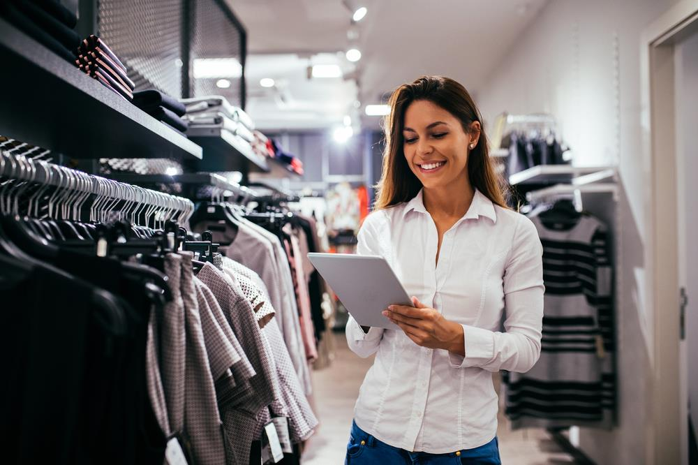 retail management professional checking clothing inventory