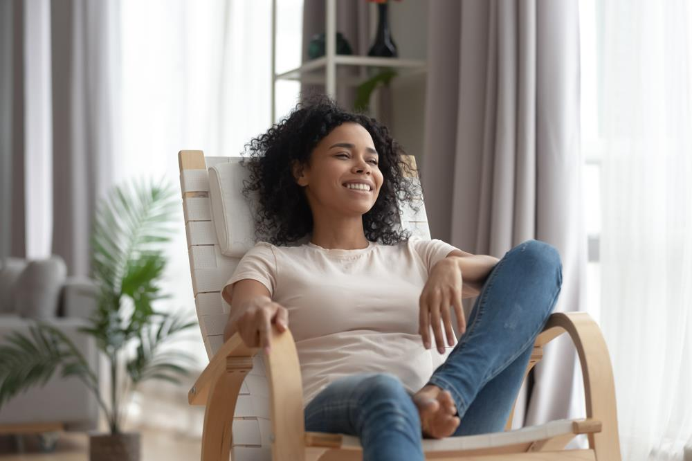 Woman sitting down in a chair.