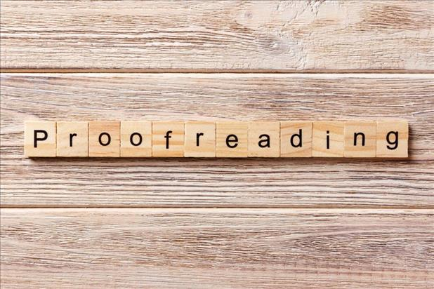 proofreading spelled with wooden letters