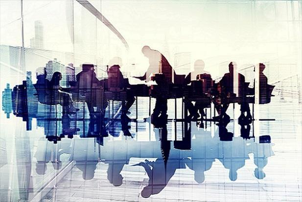 Stylized image of a crowded conference room inside a modern office