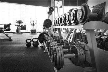 black and white photo of gym interior