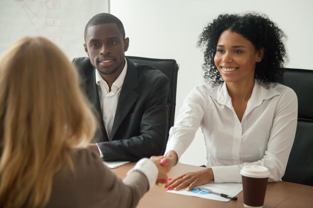 two people interviewing job candidate