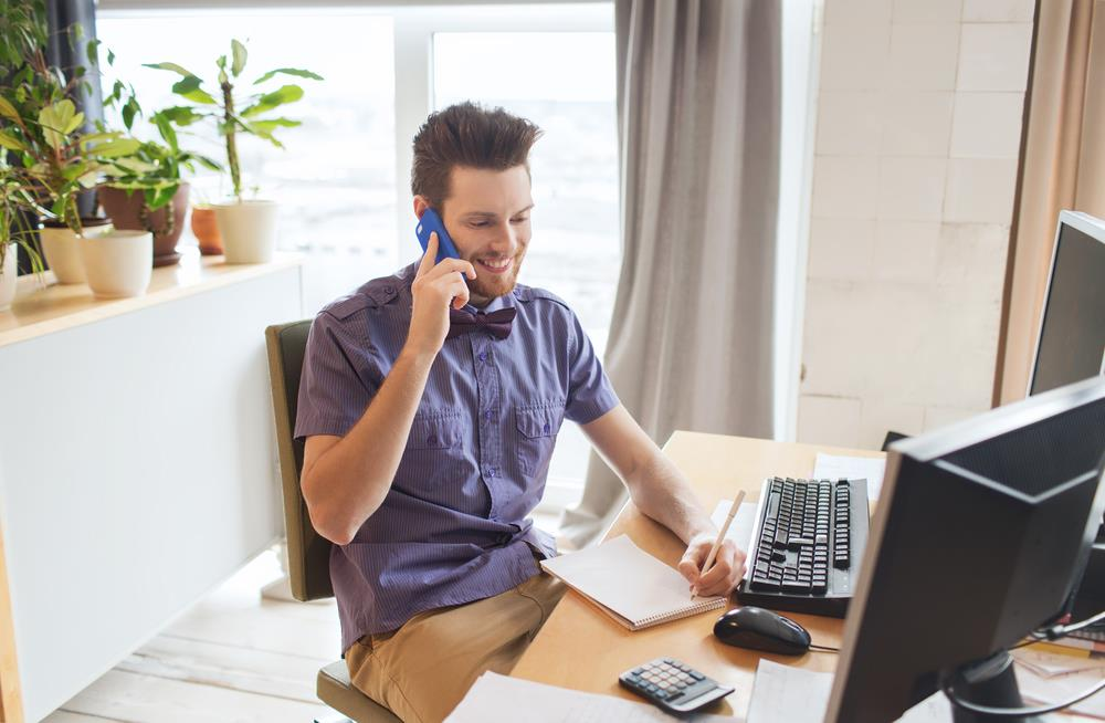 job seeker at home on the phone talking to a prospective employer