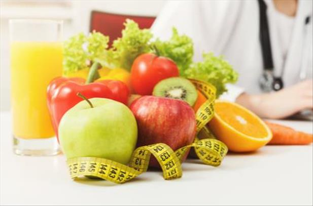 nutritionist with fruit bowl