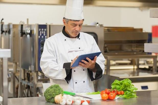 Sous chef in the kitchen reading resume writing tips