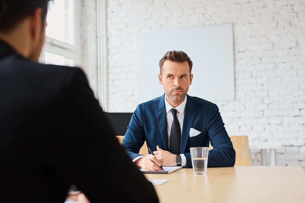 interviewer with a serious face not providing information in return