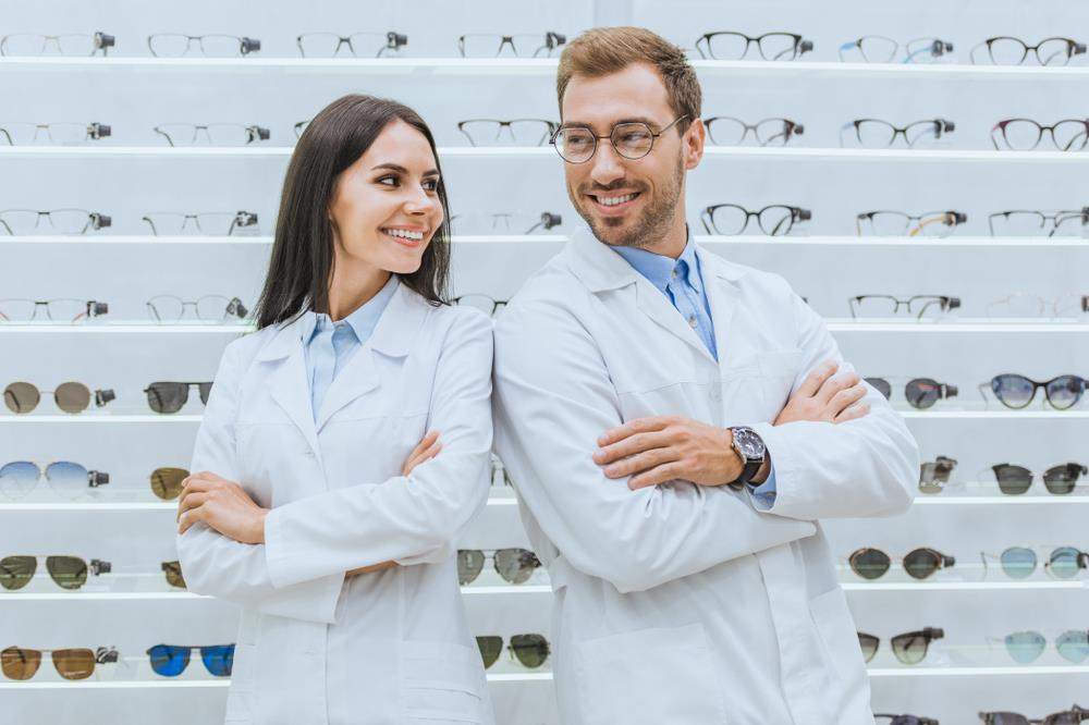 two optometry team members at work