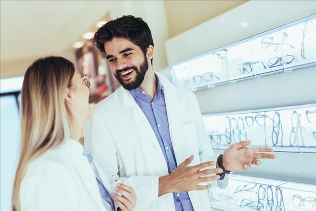 happy optometry team members chatting in their practice
