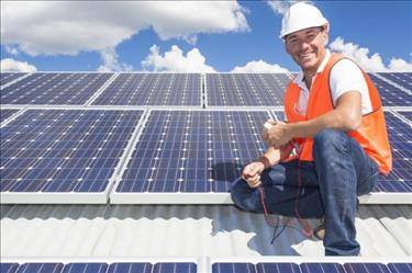 Smiling solar installation technician who enjoys working in the utilities industry