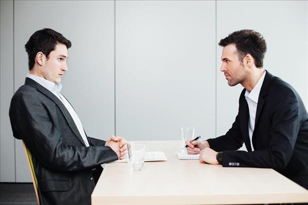 interviewer and interviewee in a stressful interview