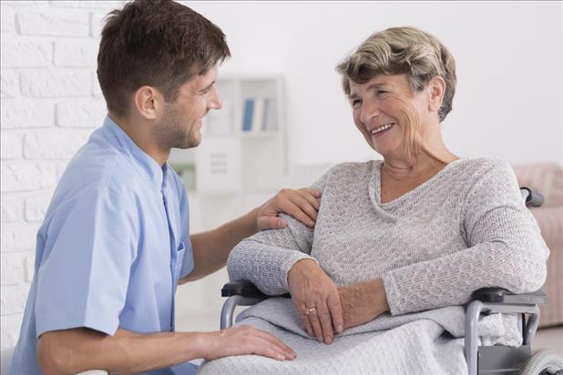 caregiving professional helping a patient