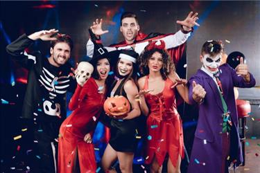 group of employees at a halloween office party