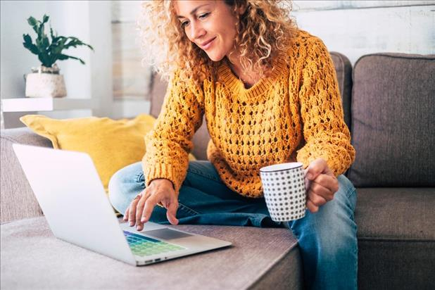 woman with colorful keyboard working on her resume