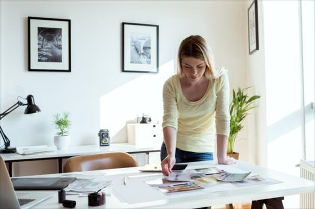 Young woman works on preparing her professional portfolio