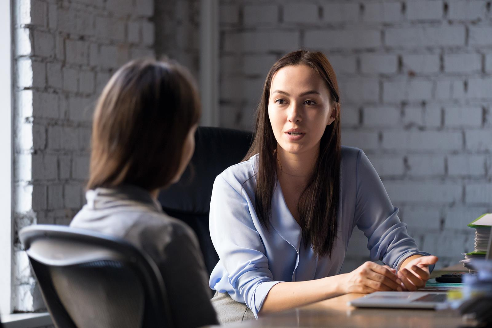 Woman conducting an interview with another woman