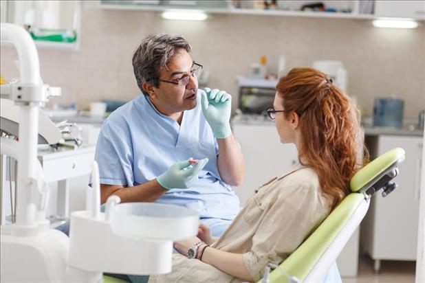 Dentist speaking with patient