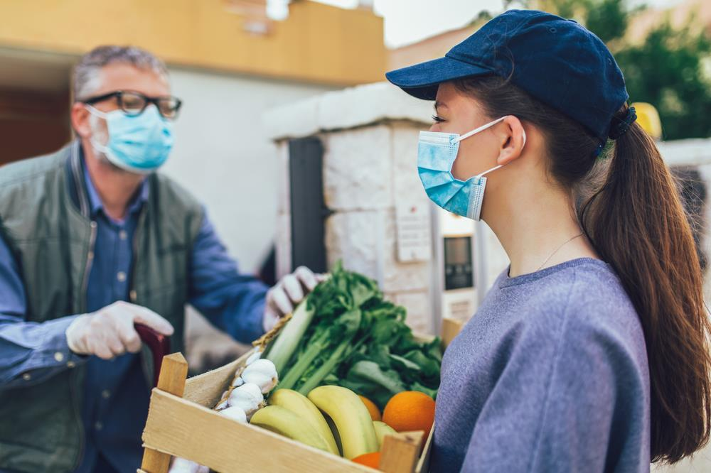 People volunteering at a food bank during pandemic